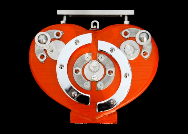 Red-y to wear. A heart shaped minaudiere