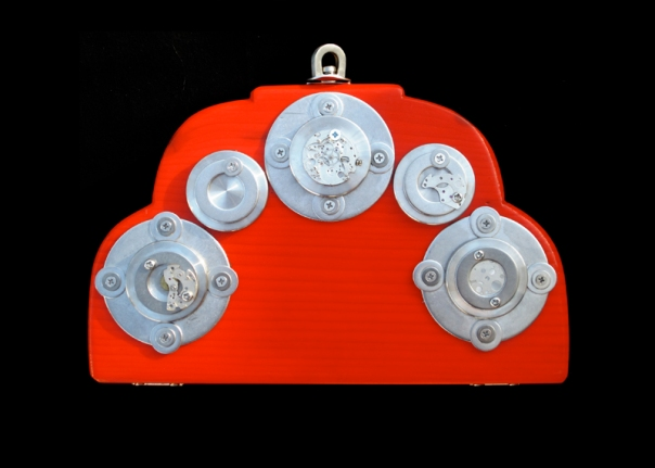 Crimson clutches: Handpainted and embellished with automatic watch parts